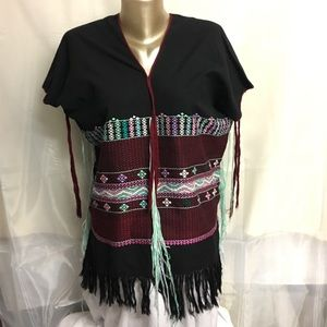 Embroidered poncho with tassels